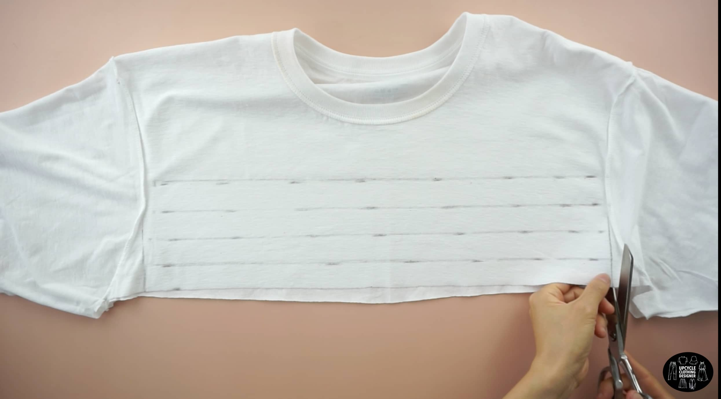 Cut four straps on the front of the original tee to make drawstrings