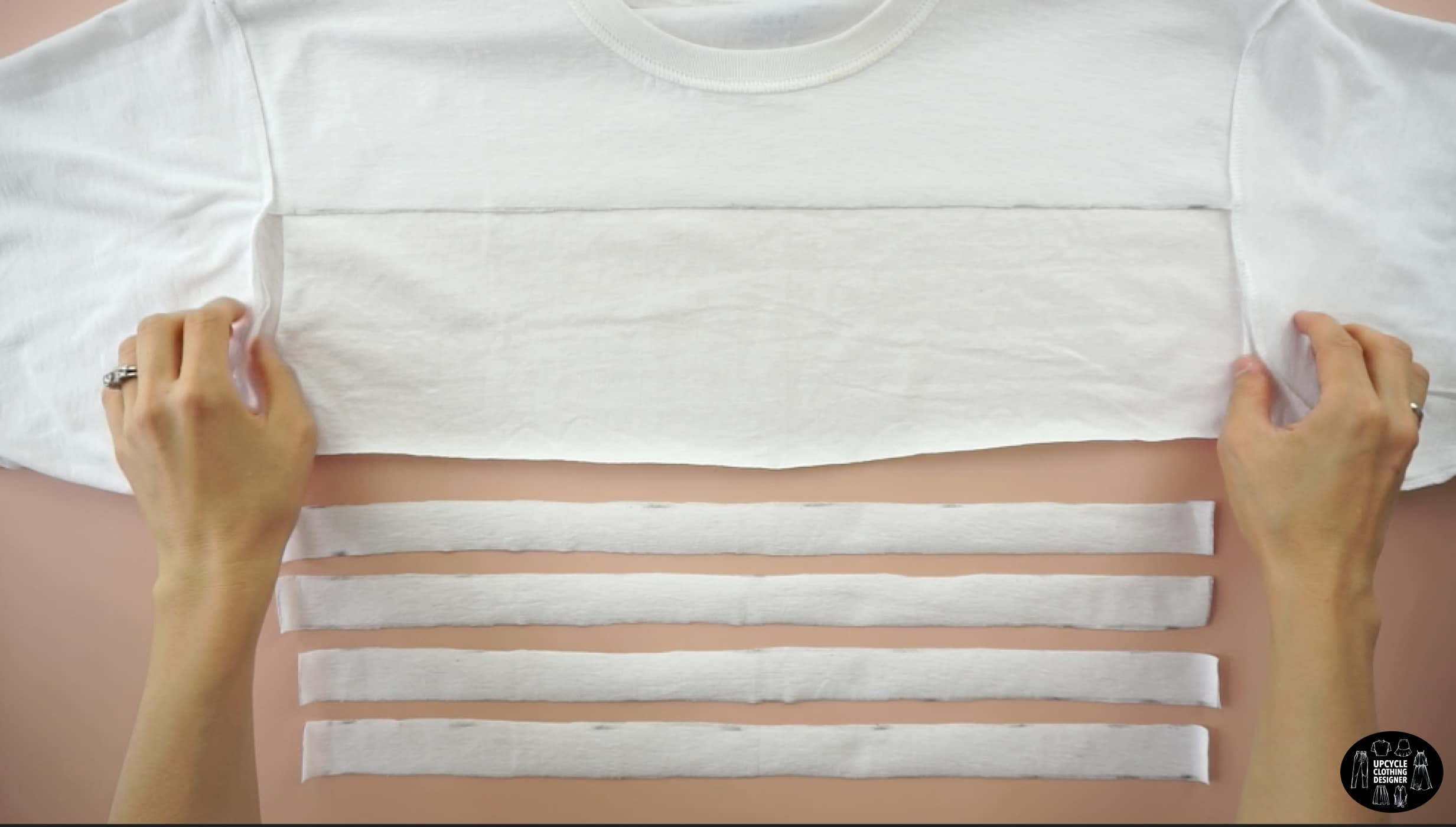 Cut four straps on the back of the original tee to make drawstrings