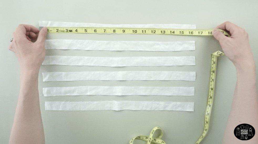 "Make six 1"" x 16"" straps to make drawstrings for the tie front blouse"
