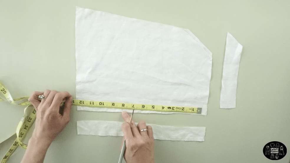 Measure to mark the placement of the tie front drawstrings