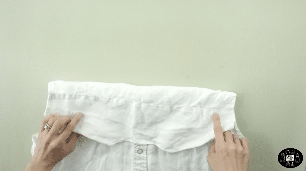 Cut along the back yoke of the men's shirt