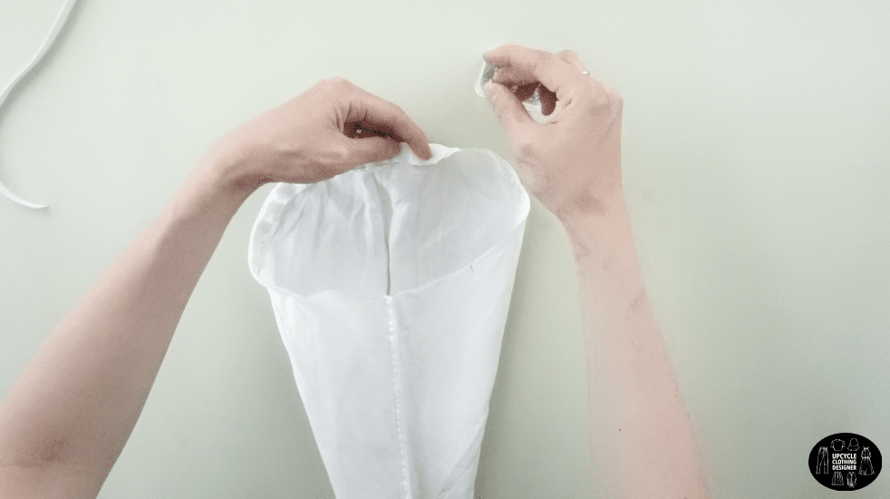 """½"""" fold around the top of the armhole to make a casing for the elastic band."""