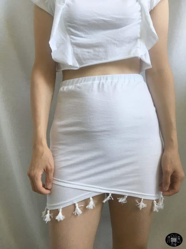 Front view of the tassel trim mini skirt from a t-shirt