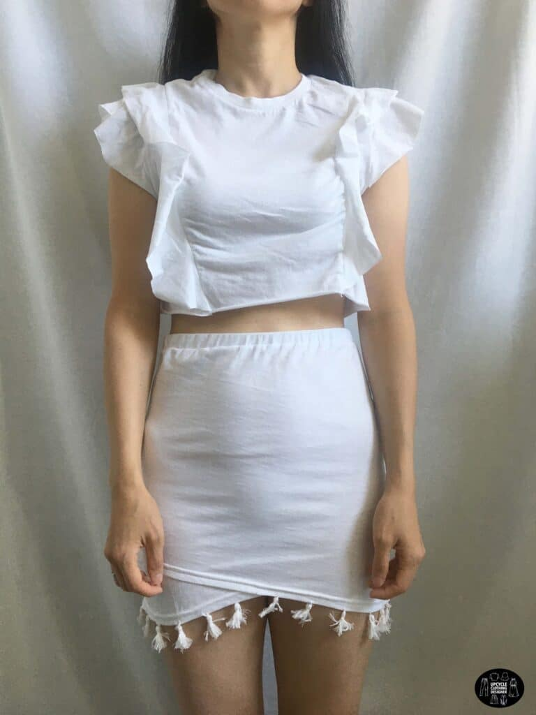 Ruffled crop top paired with the tassel trim mini skirt