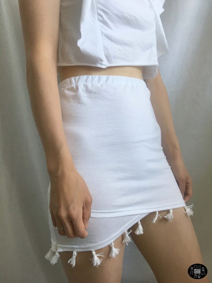 Sideview of the tassel trim mini skirt from a t-shirt