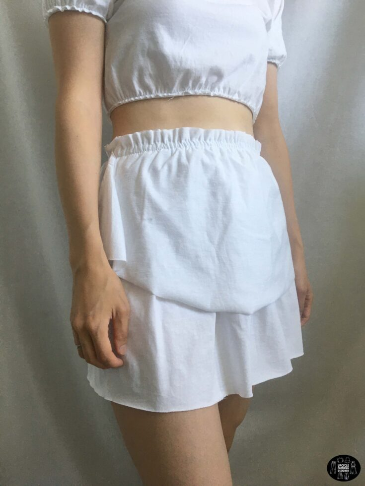 Sideview of the tiered ruffle mini skirt from a t-shirt