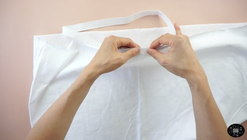 Mark four equal distances around the elastic waistband