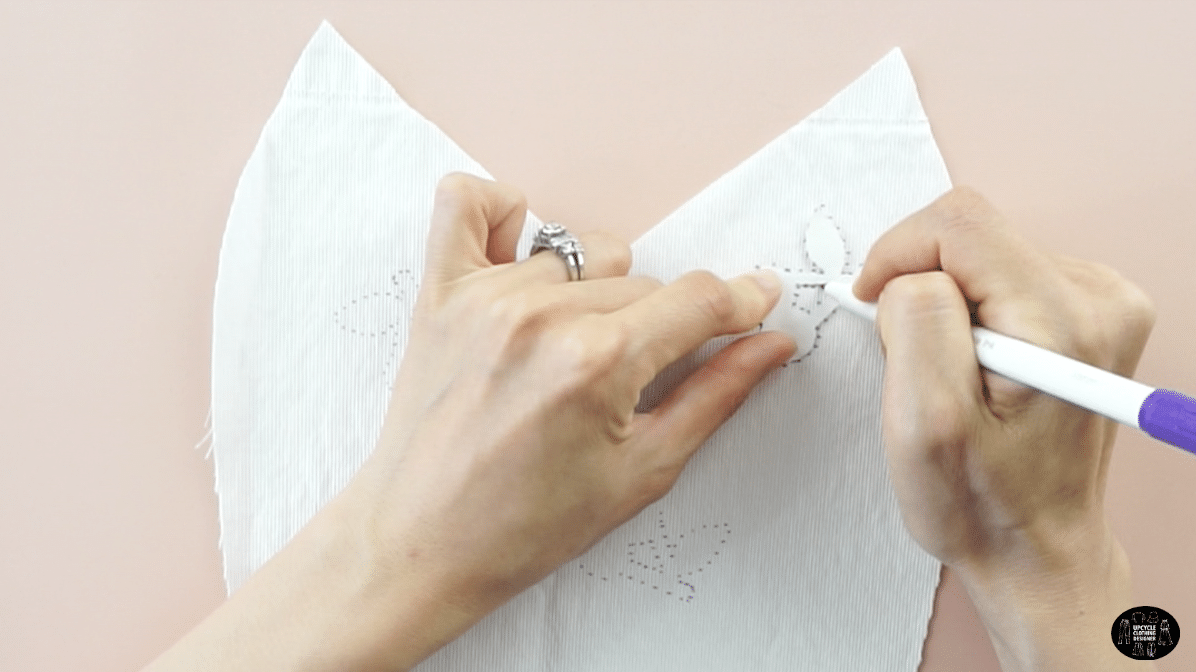 Use a disappearing pen to trace the cherry pattern onto the front of the dress.