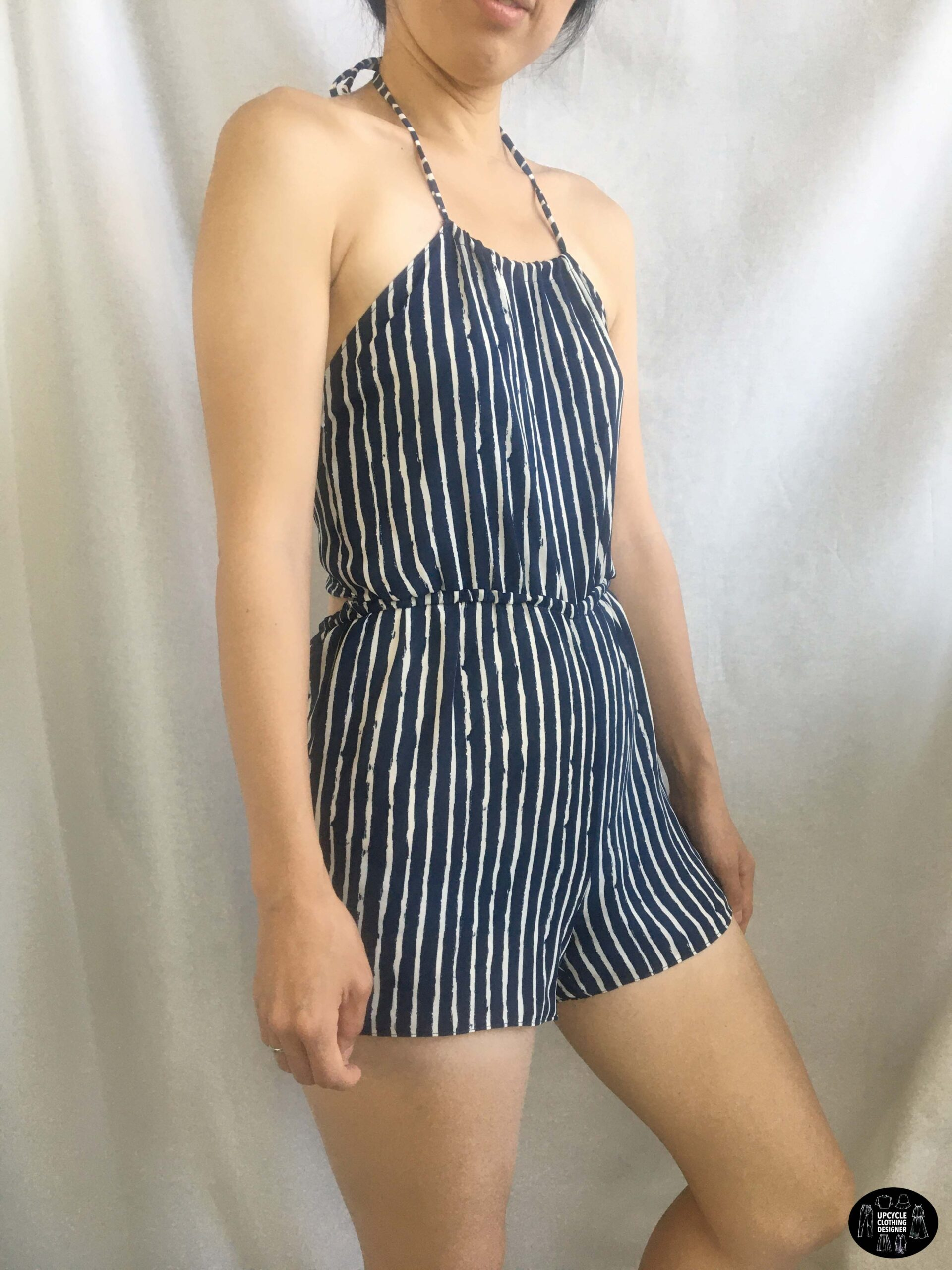 Sideview of the halter romper from dress