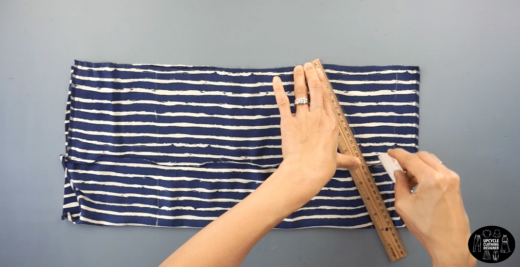 """To make the armhole, measure 4"""" down from the height of the neckline.Draw a straight line from the side seam to the halter neckline."""