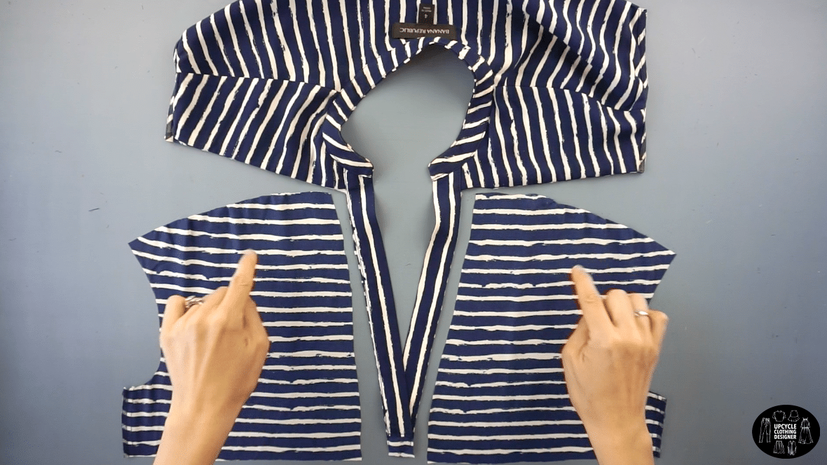 Deconstruct the top piece of the original dress. Use a seam ripper to separate the seams.