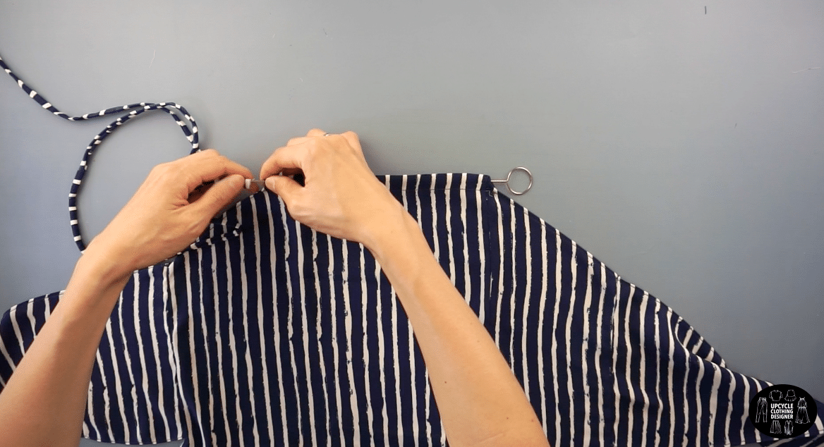 Use a loop turner to feed the strap through the tunnel on the halter neckline.