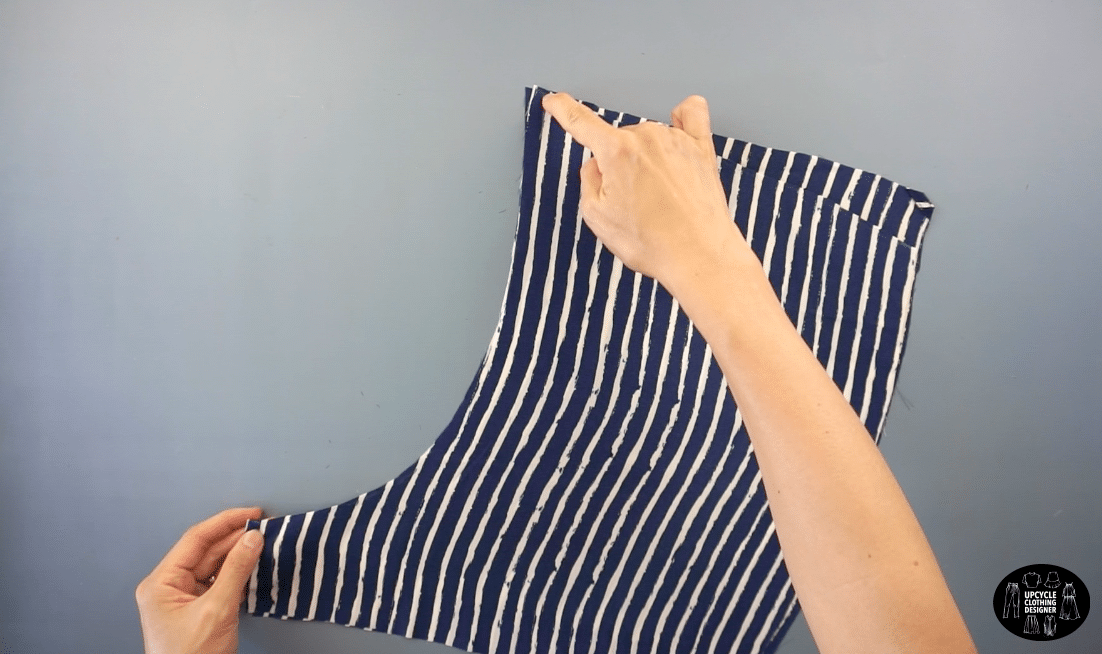 Sew along the center line with the right sides facing together to join the front shorts pieces.
