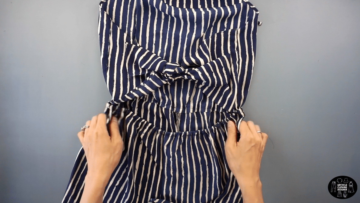To finish the halter romper from dress, knot the back tie pieces together.