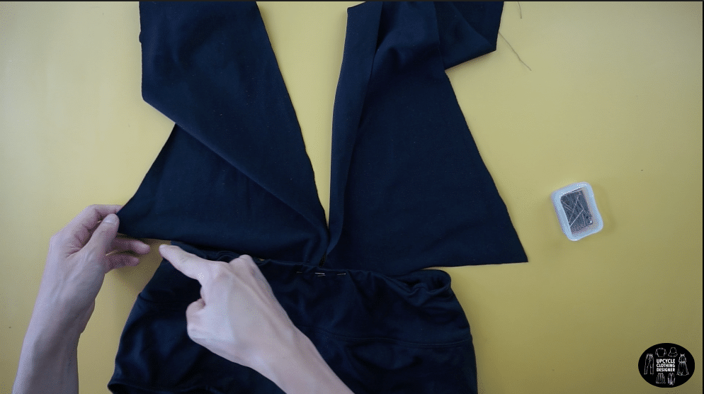 Pin the top of the swimsuit to the waistband on the bottom of the swimsuit.