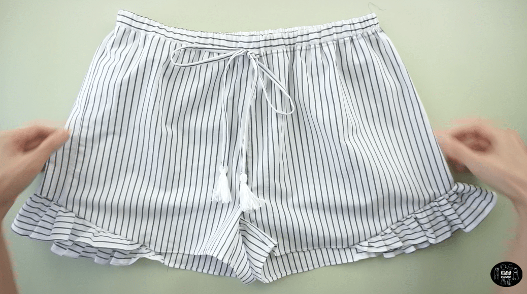 Attach the tie front straps to the center waistline of the DIY shorts from men's dress shirt.