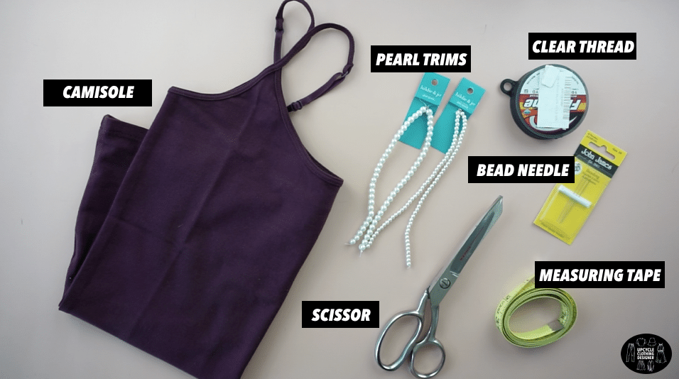 Materials to make a pearl strap camisole top.