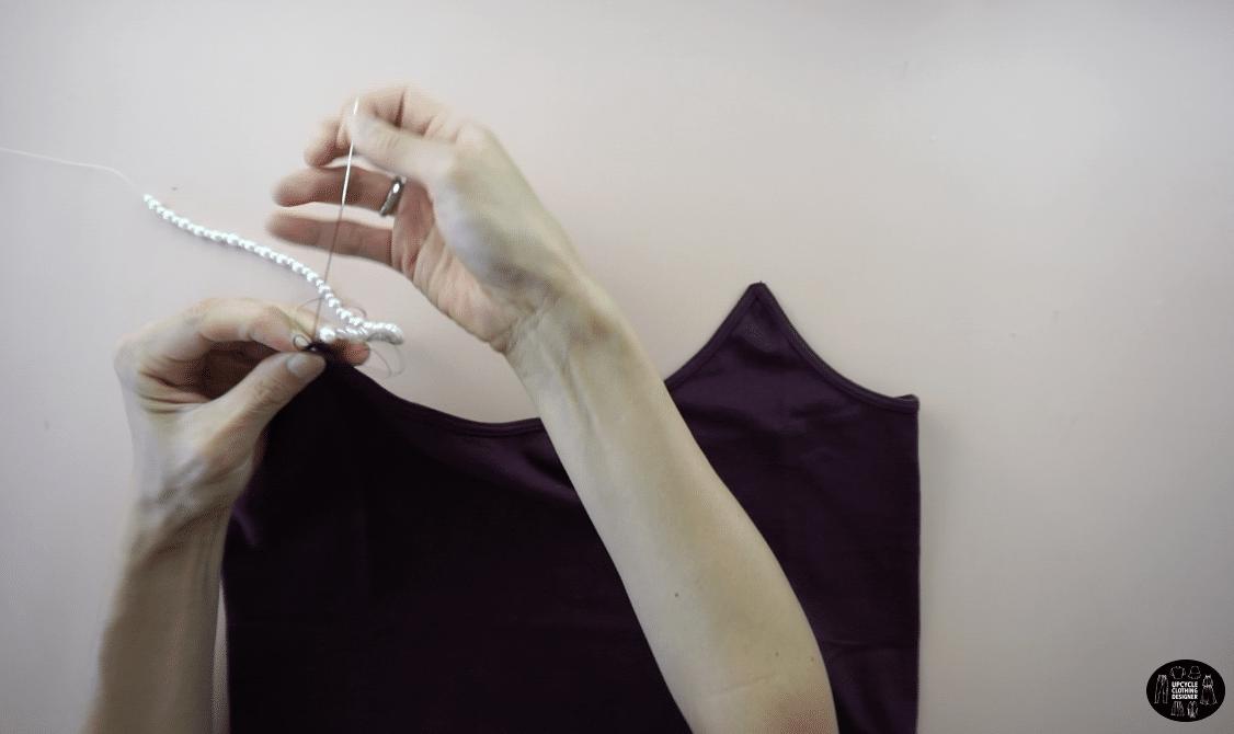 Attach the pearl strap to bodice.