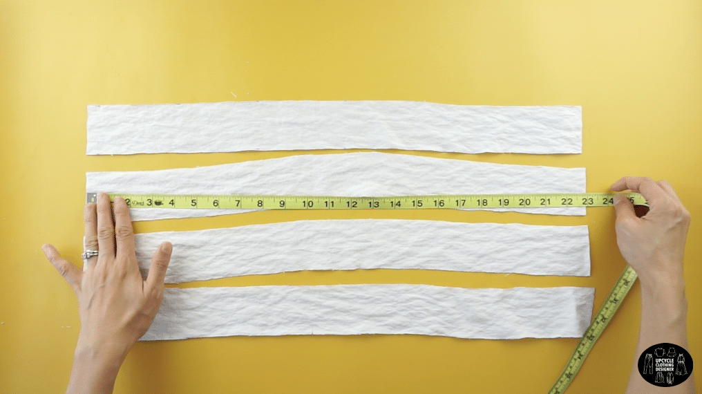 """To make the front button facing, measure two 2"""" x 23"""" pieces of fabric."""