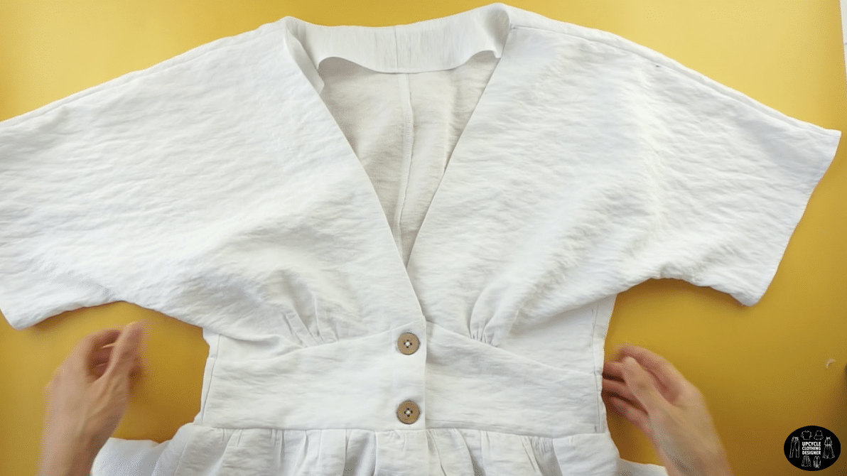 Line up the buttonholes and fasten the closure to finish this DIY button front kimono dress.