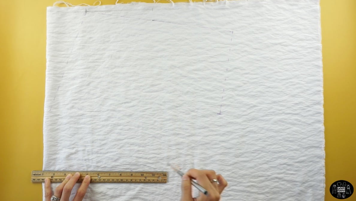 """To measure the waistline of the dress, measure 15"""" down from the top edge. Then, measure 10"""" away from the side edge."""