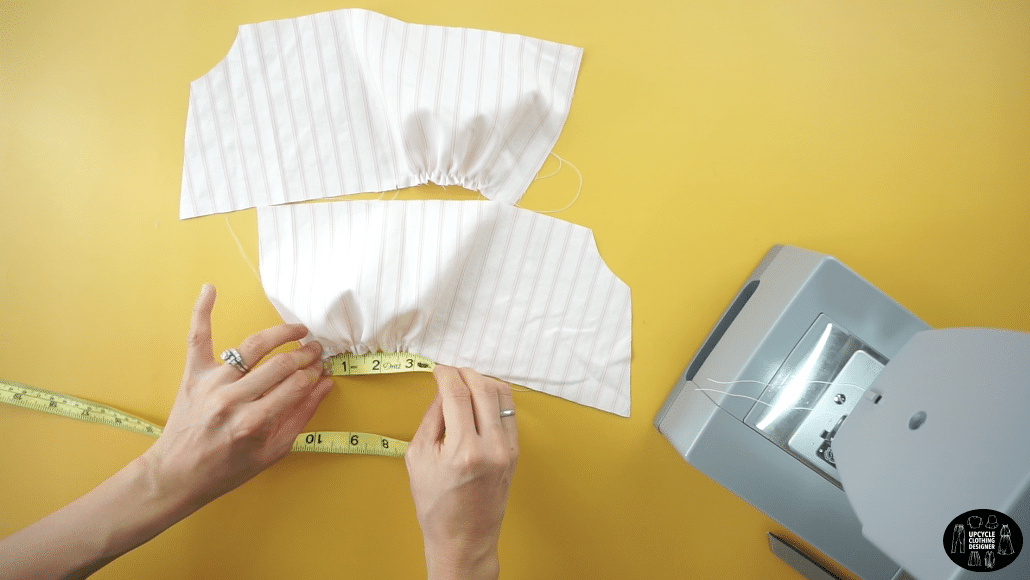 """Gently pull on the back thread to gather the fabric to a width of 3½"""" and create bunching around the bust."""