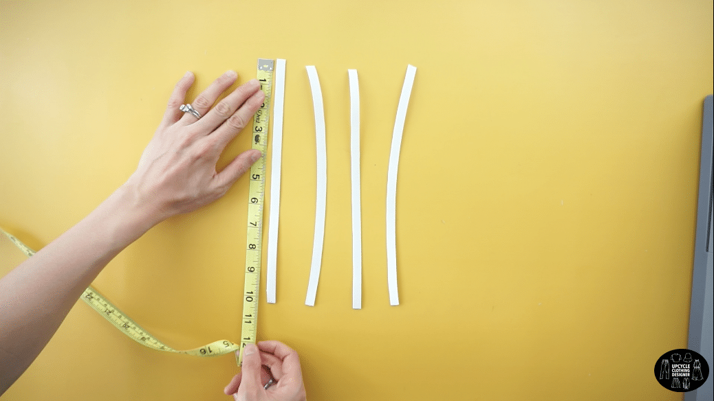 """cut four separate 10"""" long pieces of ¼"""" elastic band."""