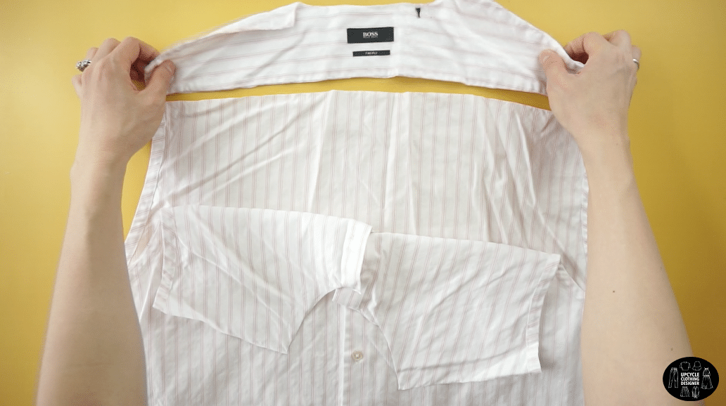 Cut along the shoulder seams, and also across the back yoke.
