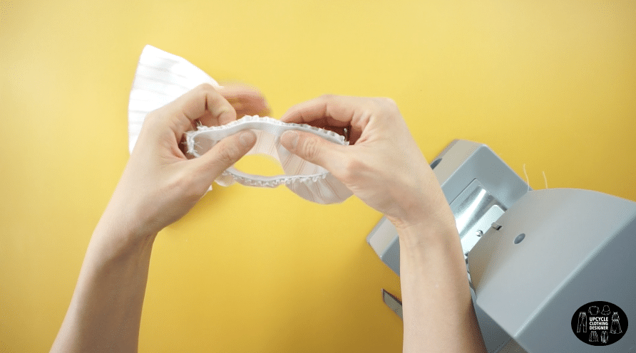 Stretch the elastic band and topstitch around the sleeve opening.