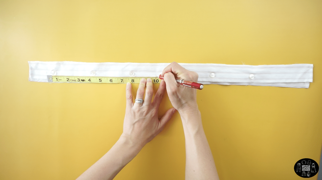 """Measure 10"""" along both plackets and cut."""