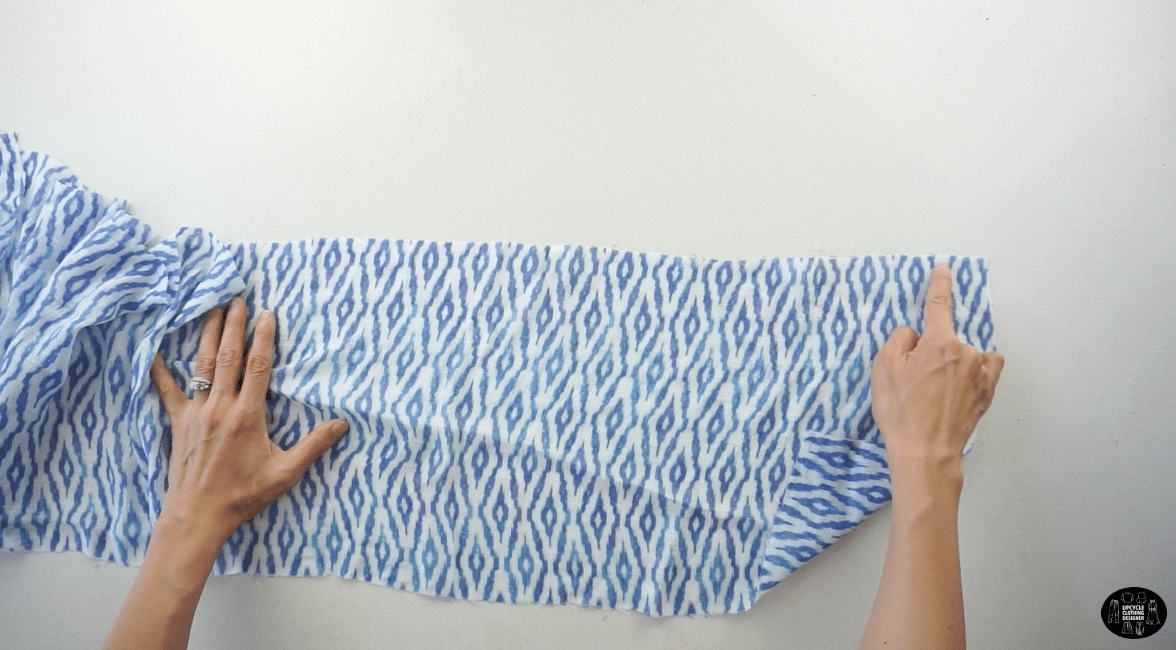 """To add shirring to the top dress tier, use wide stitch width and loose tension. Sew two straight stitches ¼"""" apart along the top edge of the top dress tier."""
