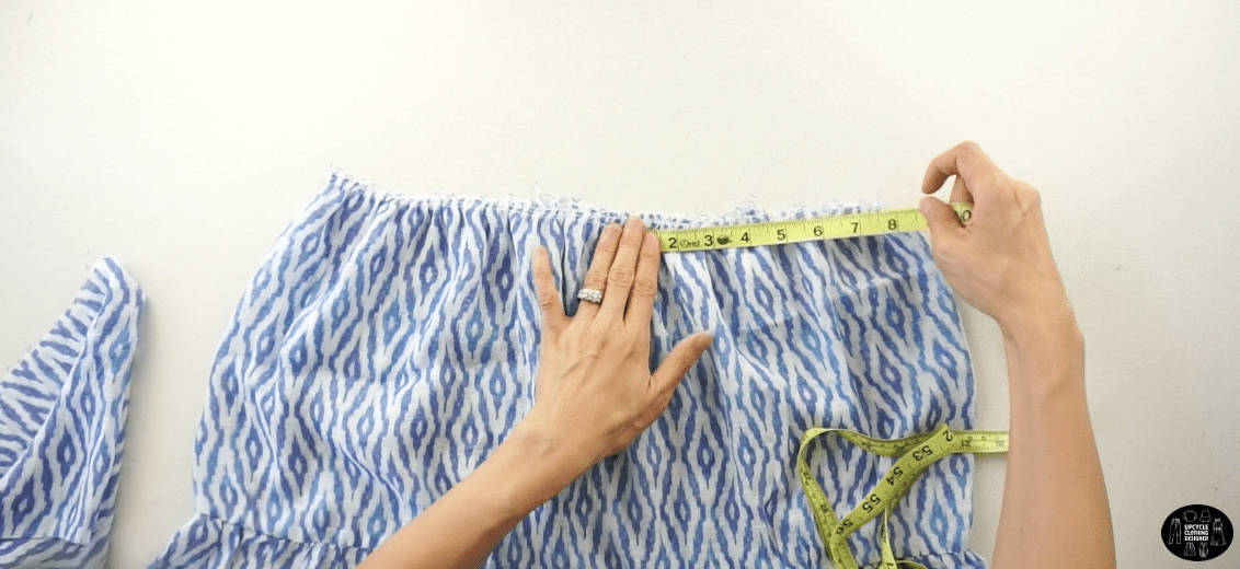 To complete the top of the dress, attach the top bodice and tiered bottom with the right sides facing together. Line up the top bodice center with the bottom dress center.