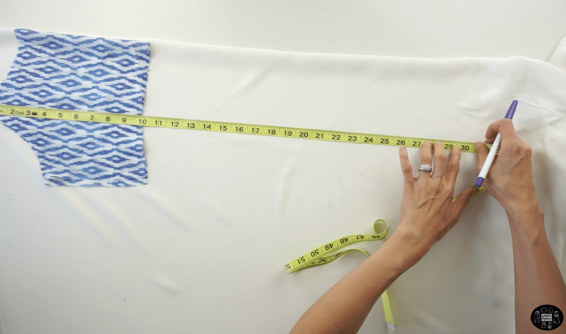 To make lining for the front dress piece, fold a piece of linen crepe fabric in half lengthwise. Start along the folded edge and use the front top bodice as a guide.