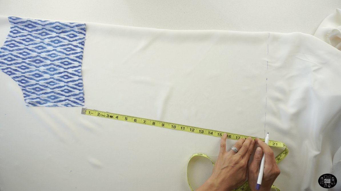 """To mark the hemline, measure 30"""" down from the high point shoulder and draw an 11½"""" hemline perpendicular to the folded edge. Draw a straight line to connect the side seam with the hemline."""