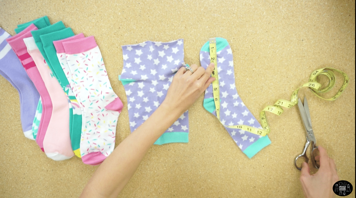"Grab a bunch of colorful socks. Remove the toes by cutting them off about 2"" away from the tip."