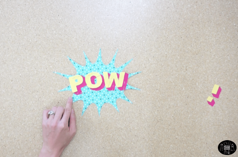 Topstitch the POW lettering onto the background piece.