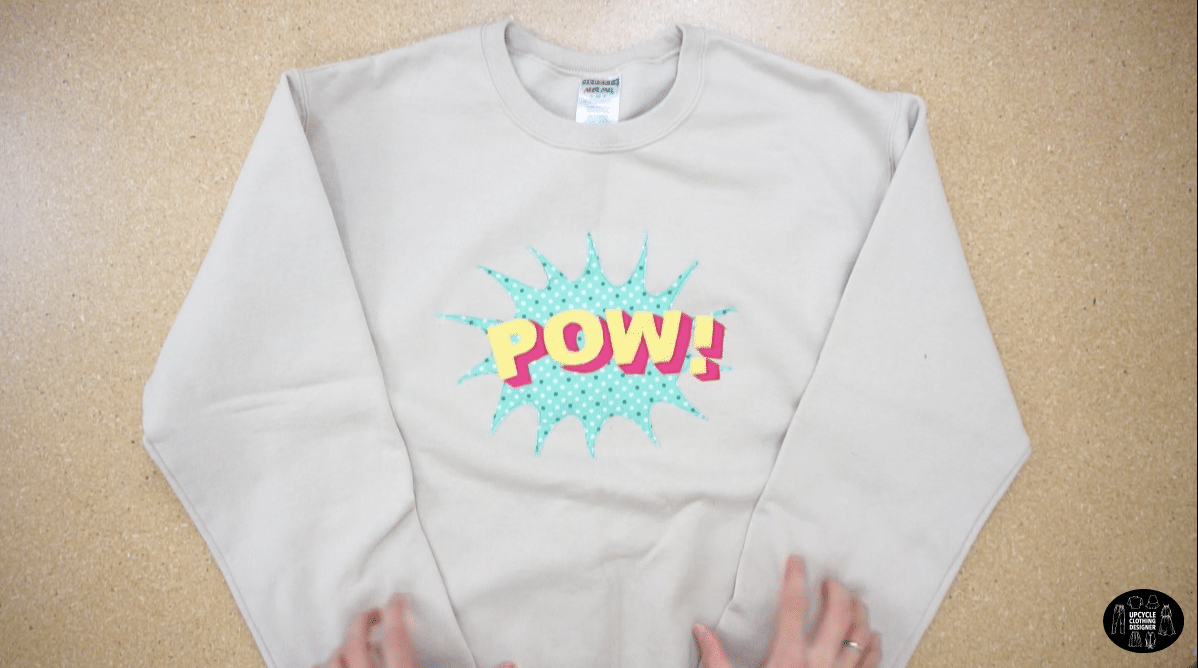 POW applique patchwork on the front of a sweatshirt