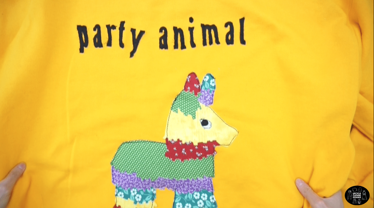 Finished party animal applique patchwork on a sweatshirt