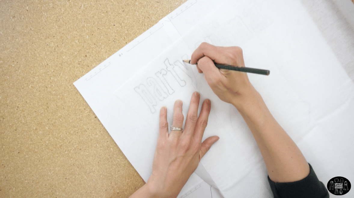 Trace the party animal applique drawing onto the pebbly side of the iron on fusible backing