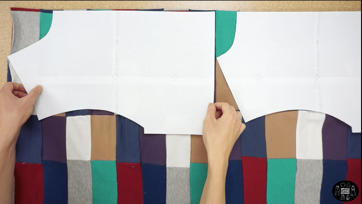 Pin the sewing pattern pieces to the patchwork fabric