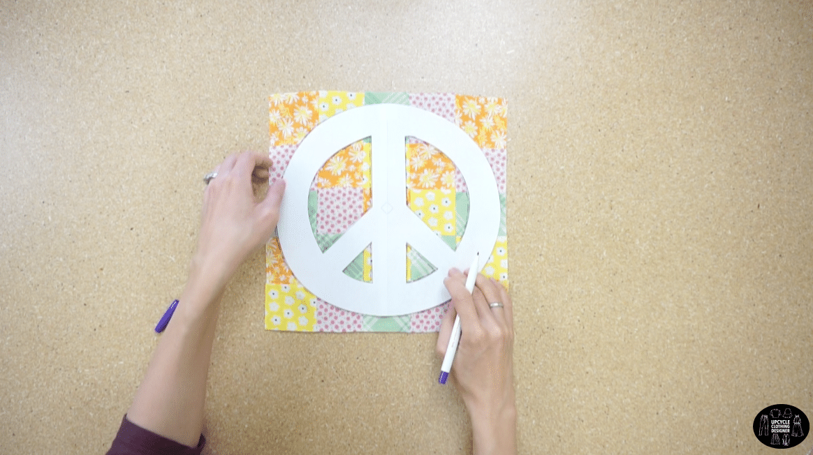 Trace the peace sign motif onto the patchwork fabric