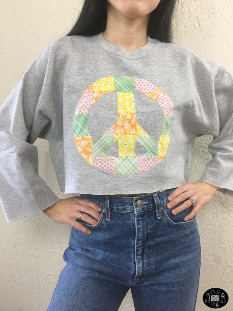 Patchwork peace sign cropped sweatshirt front