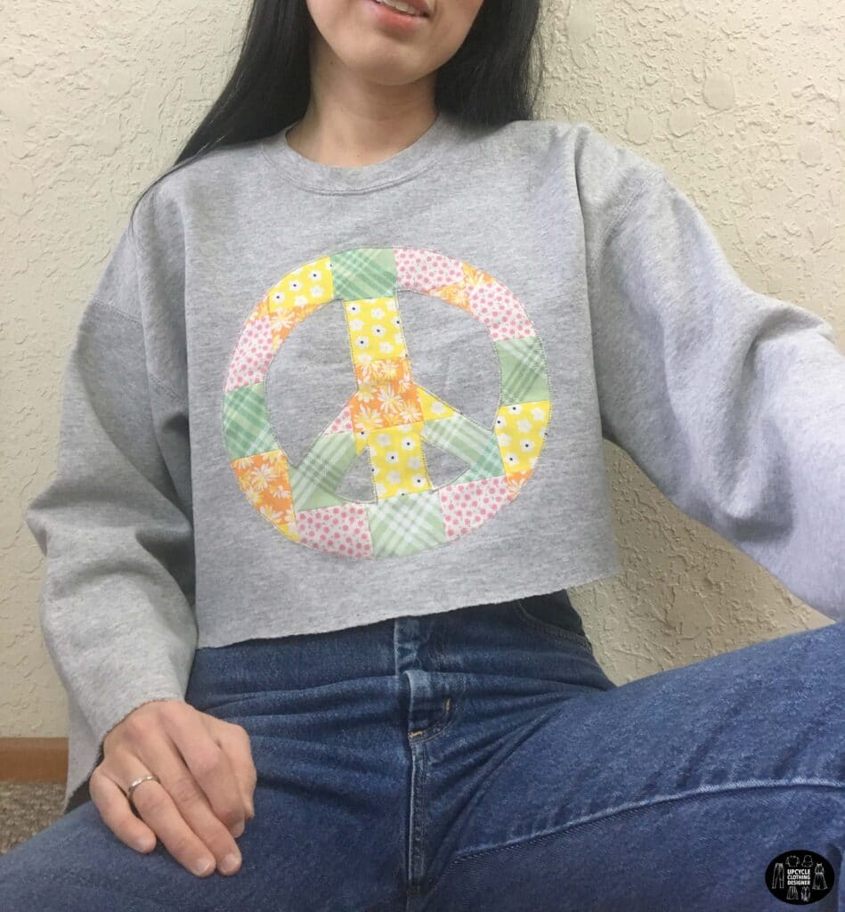 Patchwork peace sign cropped sweatshirt front closeup