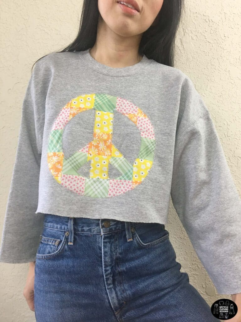 Patchwork peace sign cropped sweatshirt front view