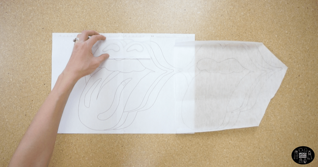 Trace the rock n' roll applique drawing onto the bumpy side of the iron on fusible backing