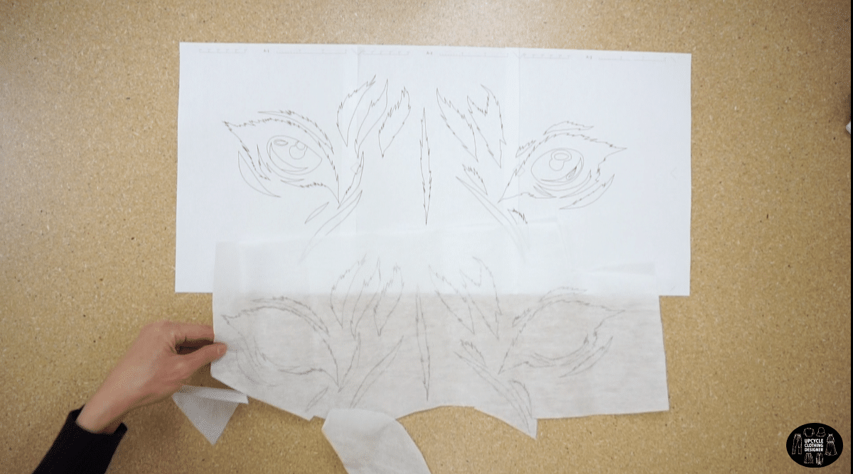 Trace the tiger eye motif onto iron on fusible backing