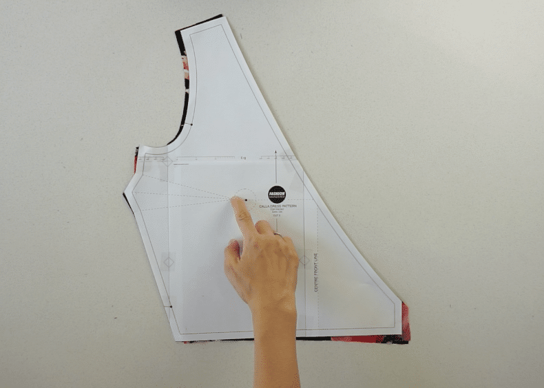 Locate the position of the bust dart on the front bodice pattern piece.