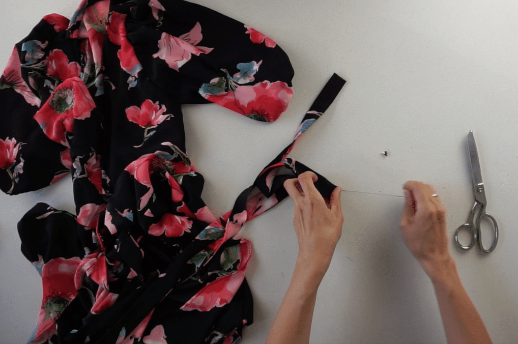 Fold the end of the waist straps inside the tunnel and hand sew along the edge.