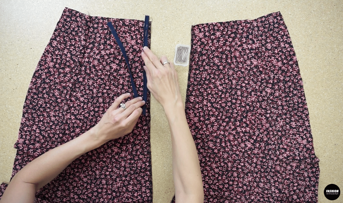 To attach a zipper to the back of the dress, open the zipper and join the placket tape to the center back opening starting at the waistline on both sides.