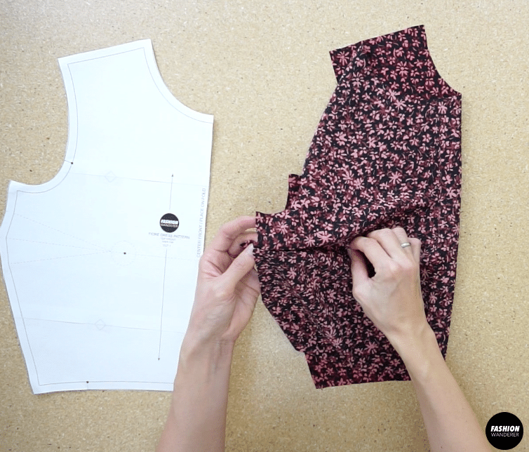 Fold the fabric along the marking, pin to secure and close the bust dart.